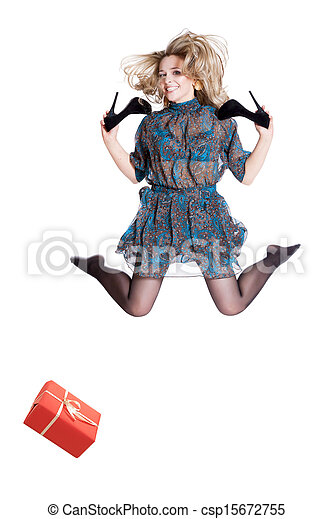 Beautiful young blonde jumping with shoes in hand - csp15672755