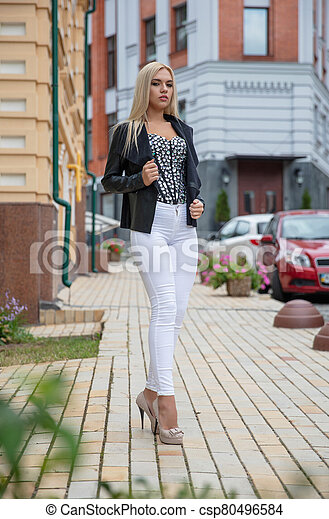 Beautiful young blonde posing outdoors - csp80496584