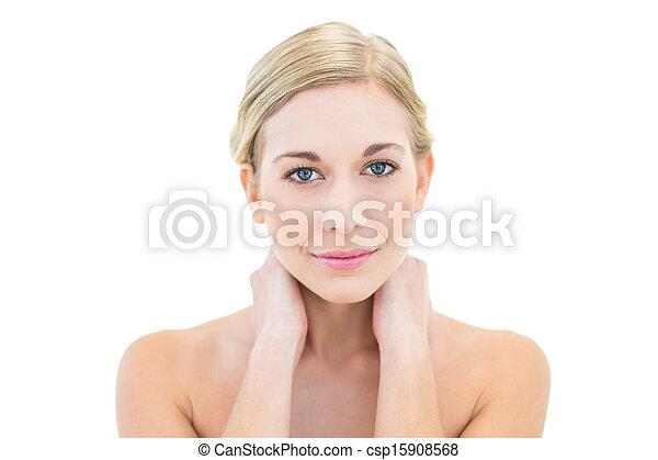 Beautiful young blonde woman looking at camera - csp15908568