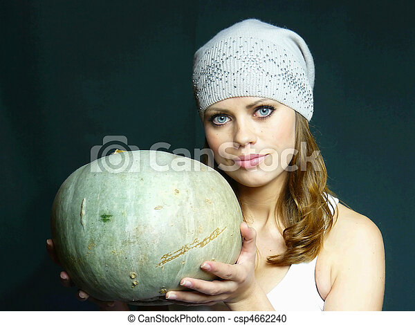 beautiful young blue-eyed girl with a pumpkin in hands - csp4662240