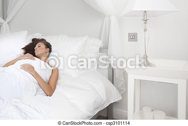 Beautiful young brunette woman sleeping - csp3101114