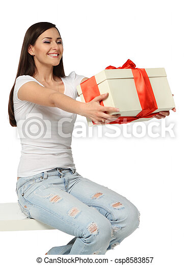 Beautiful young brunette woman with present - csp8583857