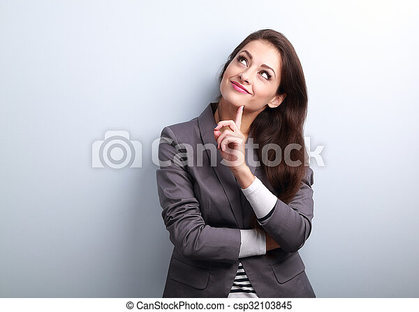 Beautiful young business woman thinking and looking up - csp32103845