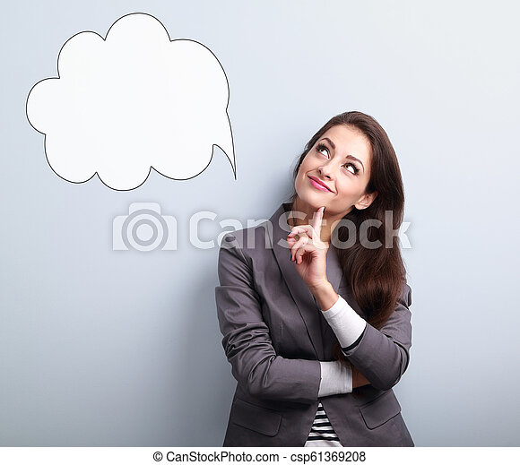 Beautiful young business woman thinking and looking up on balloon cloud above on blue background - csp61369208