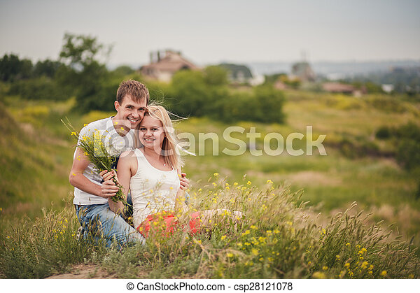beautiful young couple in a field - csp28121078