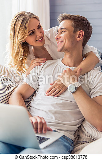 Beautiful young couple with gadget - csp38613778