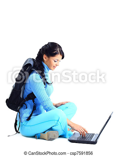 Beautiful young female student with a laptop, isolated on white  - csp7591856