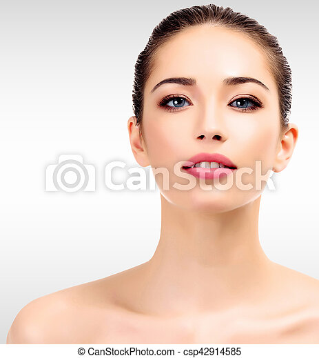 Beautiful young female with clean fresh skin - csp42914585