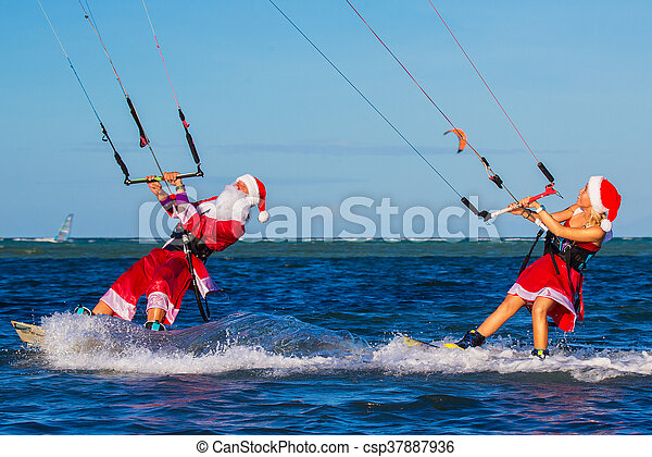 Beautiful Young Girl And Man On The Kites In The Costume Of Santa