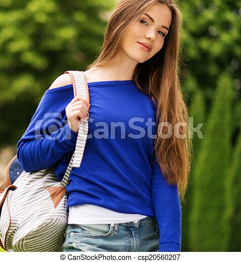 Beautiful young girl in a city park on summer day - csp20560207