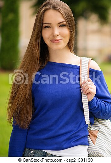 Beautiful young girl in a city park on summer day - csp21301130