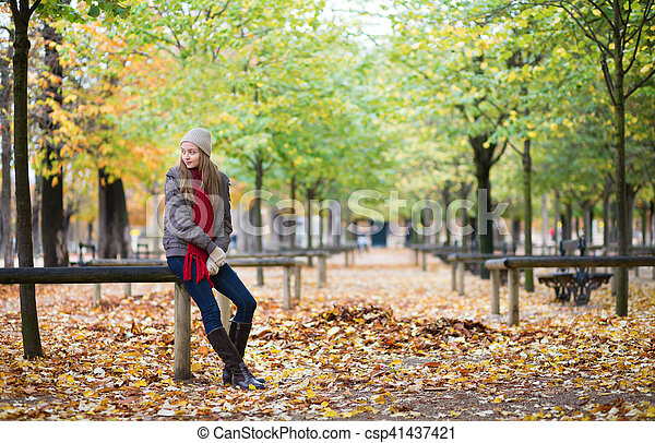 Beautiful young girl in a park on a fall day - csp41437421