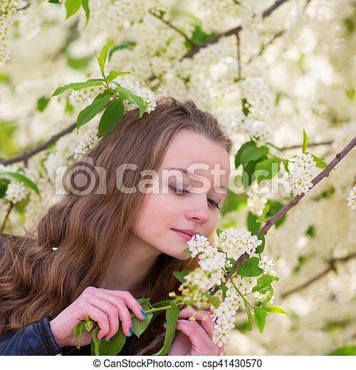 Beautiful young girl in a park on a spring day - csp41430570