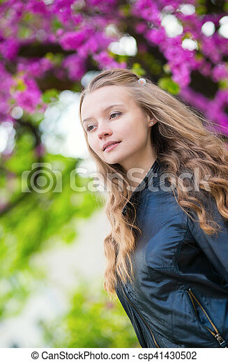 Beautiful young girl in a park on a spring day - csp41430502