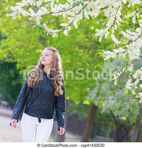 Beautiful young girl in a park on a spring day - csp41430530