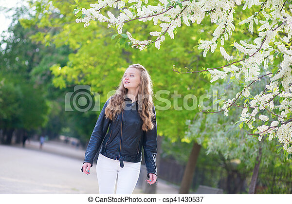 Beautiful young girl in a park on a spring day - csp41430537