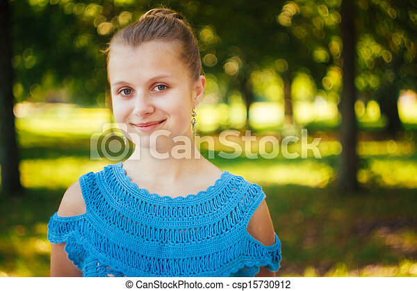 Beautiful young girl in the park - csp15730912