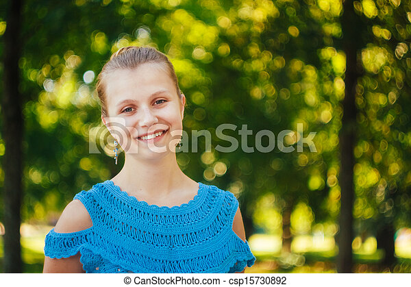 Beautiful young girl in the park - csp15730892