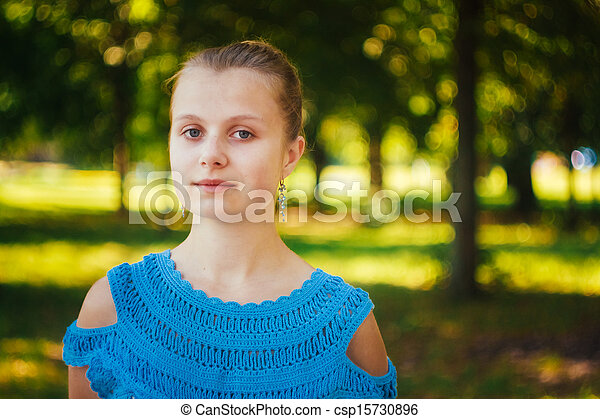 Beautiful young girl in the park - csp15730896