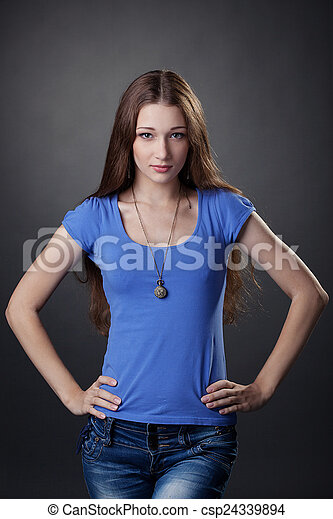 Beautiful young girl posing in casual clothes - csp24339894