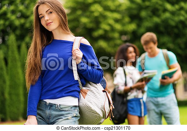 Beautiful young girl student in a city park on summer day  - csp21301170