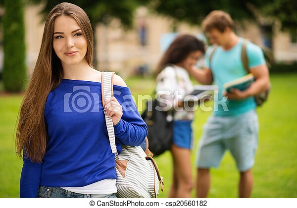 Beautiful young girl student in a city park on summer day  - csp20560182