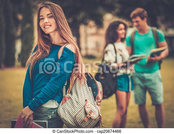 Beautiful young girl student in a city park on summer day  - csp20674466
