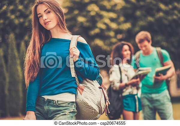 Beautiful young girl student in a city park on summer day  - csp20674555