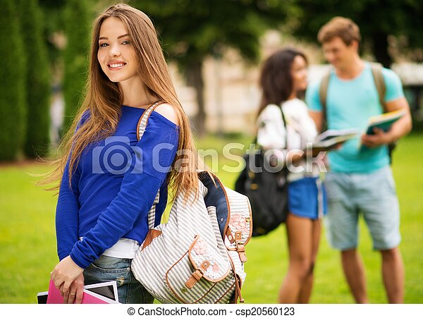 Beautiful young girl student in a city park on summer day  - csp20560123