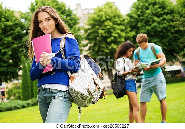 Beautiful young girl student in a city park on summer day  - csp20560227