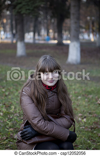 beautiful young girl with dark hair and a brown coat - csp12052056