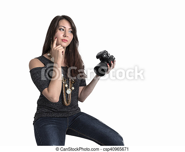 Beautiful young girl with the camera - csp40965671