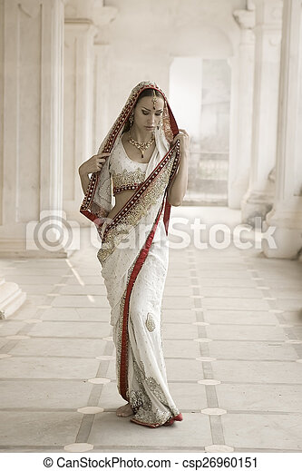 Beautiful young indian woman in traditional clothing with bridal - csp26960151