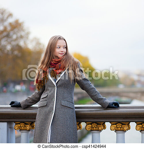 Beautiful young lady in Paris on a bridge - csp41424944