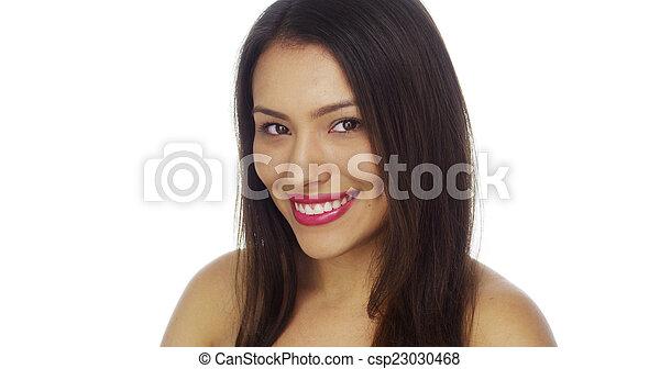 Beautiful Young Mexican woman looking at camera - csp23030468