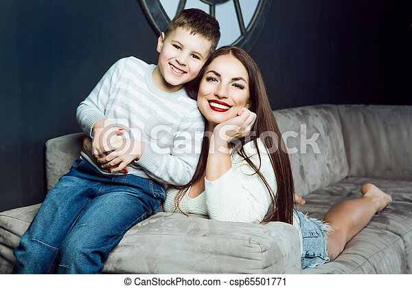 beautiful young mother with her son - csp65501771