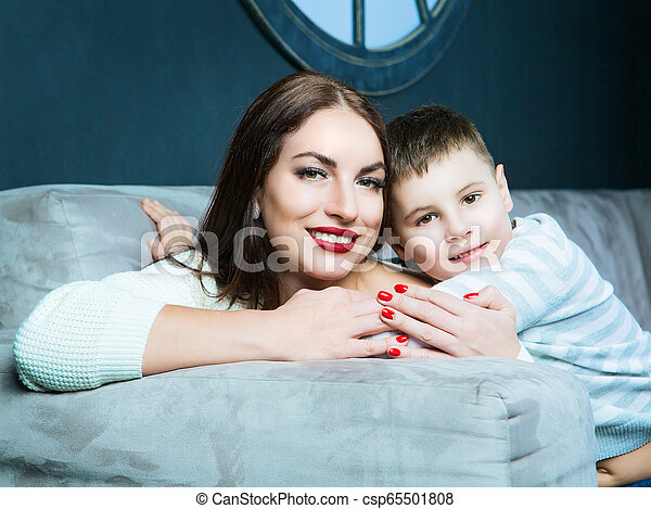 beautiful young mother with her son - csp65501808