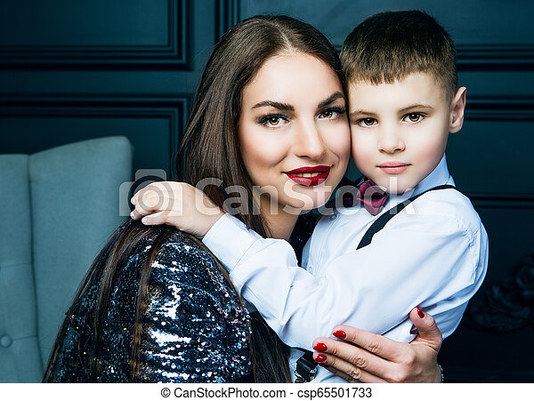 beautiful young mother with her son - csp65501733