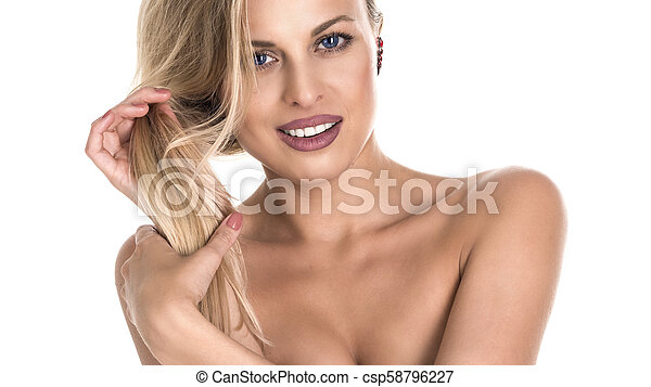 Beautiful young smiling woman. Isolated over white background - csp58796227
