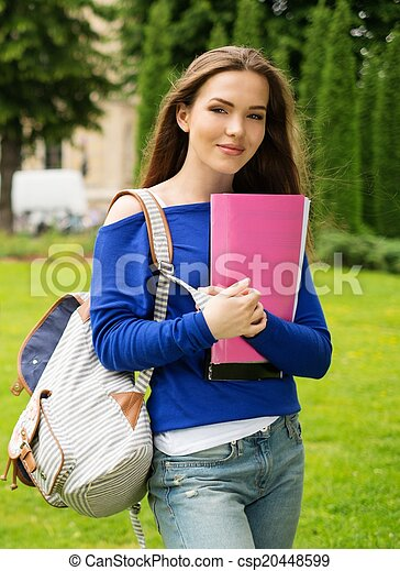 Beautiful young student girl in a city park on summer day - csp20448599