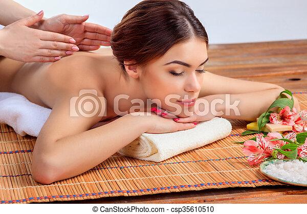 Beautiful young woman at a spa salon - csp35610510