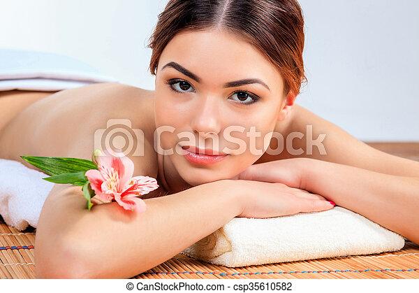 Beautiful young woman at a spa salon - csp35610582