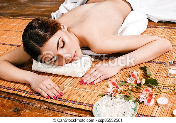 Beautiful young woman at a spa salon - csp35532561