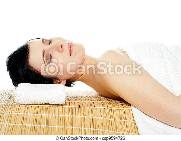 Beautiful young woman at a spa salon - csp9594726