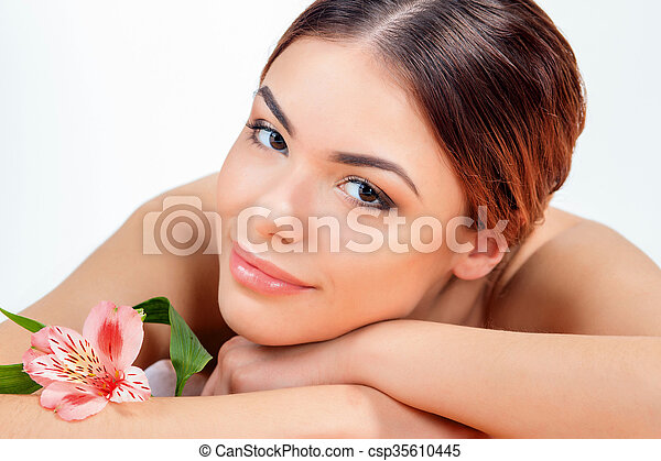 Beautiful young woman at a spa salon - csp35610445