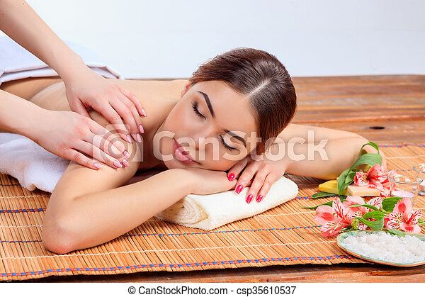 Beautiful young woman at a spa salon - csp35610537