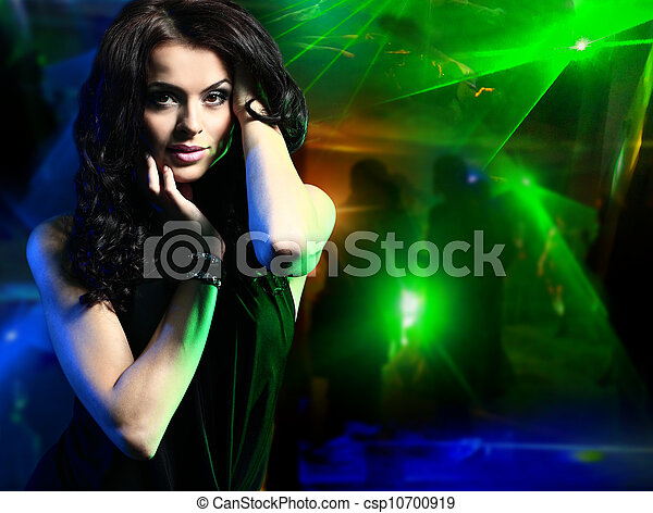Beautiful young woman dancing in the nightclub - csp10700919