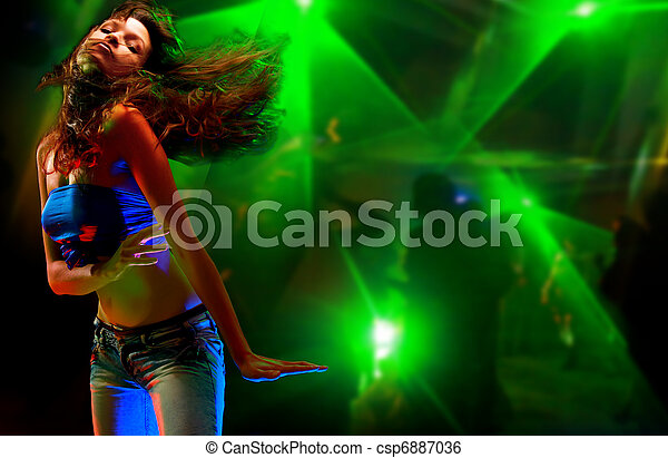 Beautiful young woman dancing in the nightclub  - csp6887036
