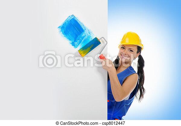 Beautiful young woman doing repairs - csp8012447