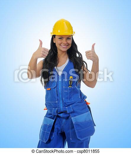 Beautiful young woman doing repairs - csp8011855